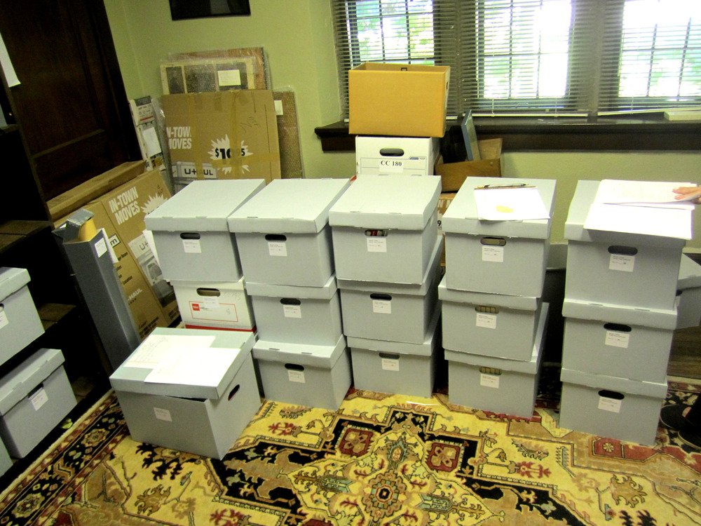 Foote collection being processed and transferred to archival storage during the creation of the finding aid.
