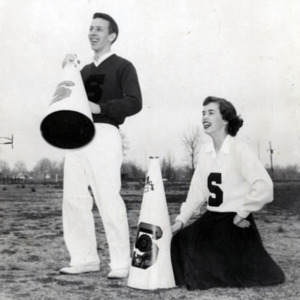 Fashion_1953_cheerleaders_with_megaphones